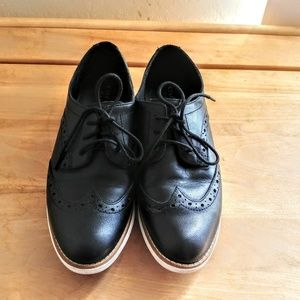 Cole Haan Black Leather Oxfords with white soles.